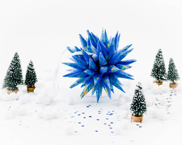 Spiky ornament made from blue and gold hand marbled paper.