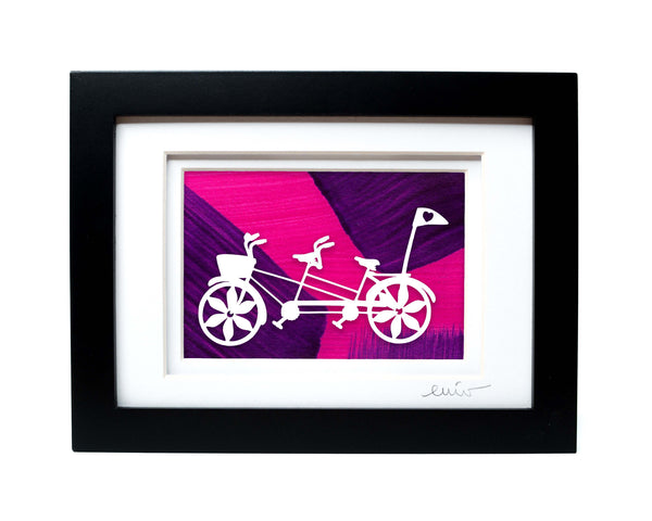 White tandem couples bike with heart flag papercut on hand painted pink and purple background.