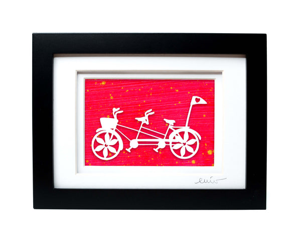 White tandem couples bike with heart flag papercut on hand painted neon pink background.