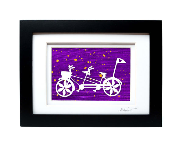 White tandem couples bike with heart flag papercut on hand painted purple background.