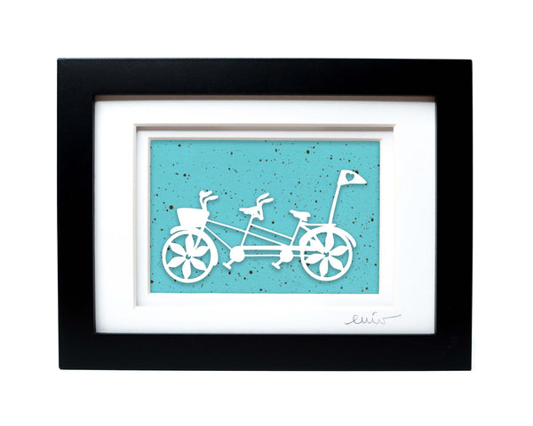 White tandem couples bike with heart flag papercut on hand painted robins egg background.