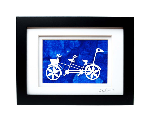 White tandem couples bike with heart flag papercut on hand painted blue bubble background.