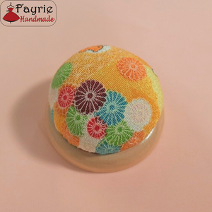 Pin cushion with wooden base