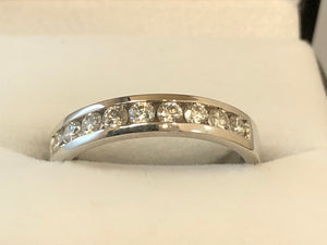 A front on extra close up of a 9-stone channel set diamond ring in 18ct white gold