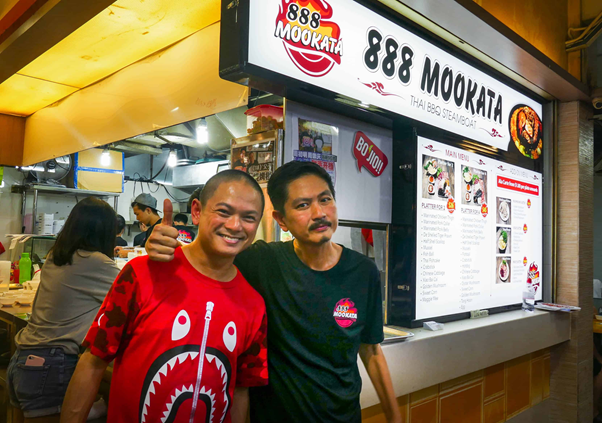 The owners posing at the 888 Mookata Tampines Branch