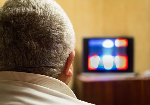 A dad watching Football on television