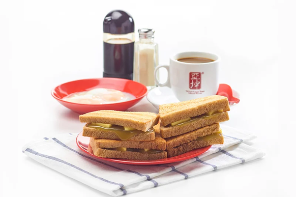 Kaya Butter Toast breakfast set with soft-boiled eggs and coffee