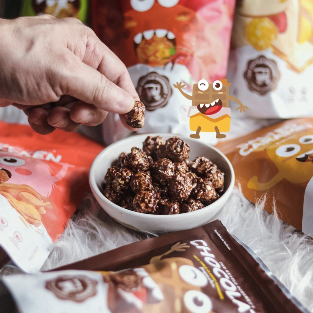 The Kettle Gourmet's chocolate popcorn and surrounding it are our Snack Monsters
