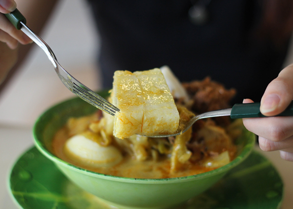 Queenstown Lontong's Lontong, or rice cakes, nestled in a broth with coconut milk