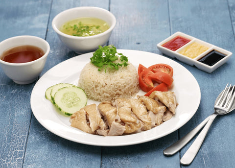 Image of chicken rice dish with sauce and soup.