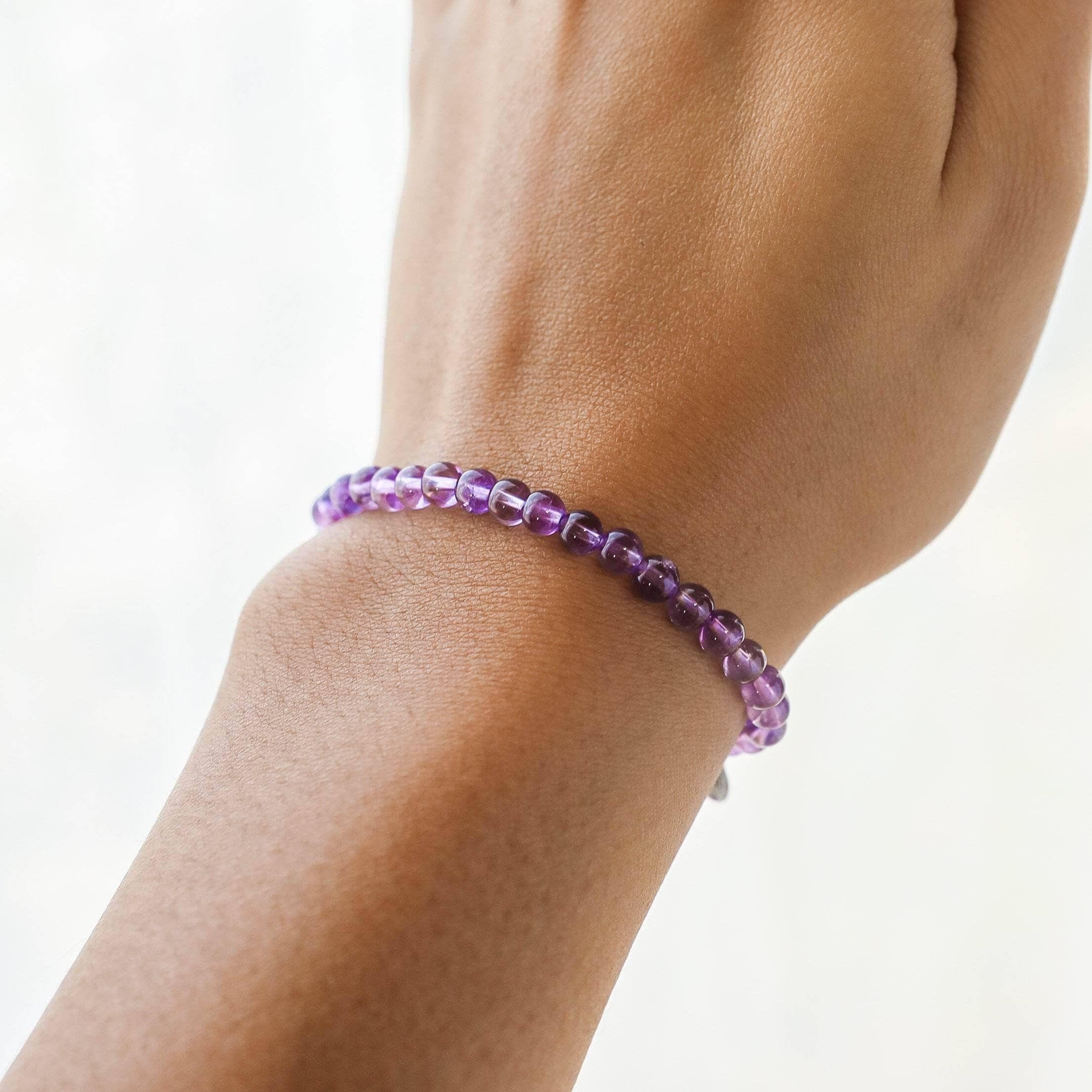 close up of wrist with amethyst energy bracelet