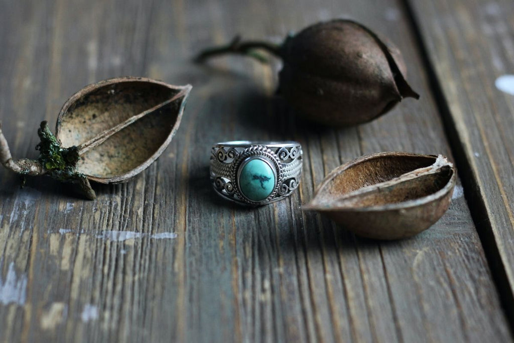 Turquoise ring on table