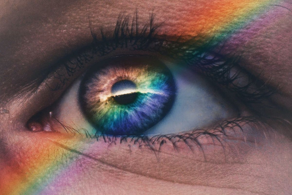 close up of womans eye with rainbow