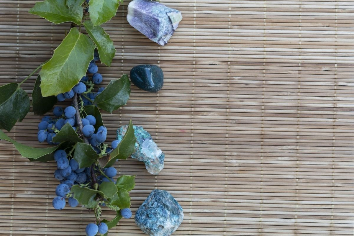 Fluorite with other crystals on bamboo