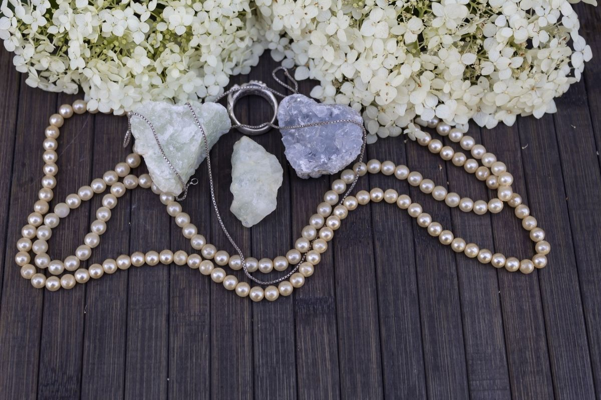 Celestite and pearls on table
