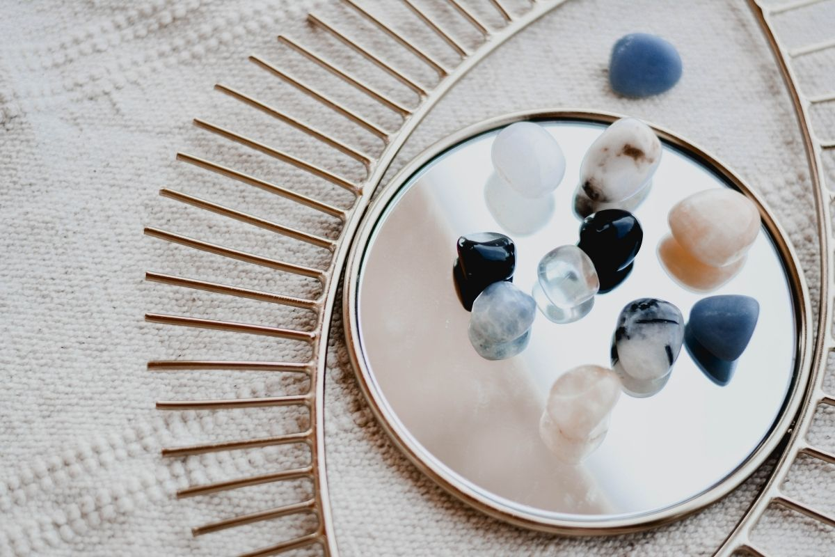 collection of gemstones on mirror