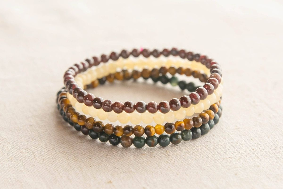 Leo Zodiac Bracelets including tigers eye, yellow topaz, garnet, and bloodstone