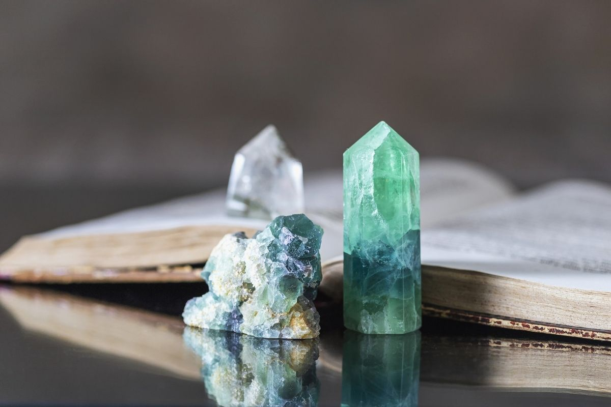 Crystals next to a book