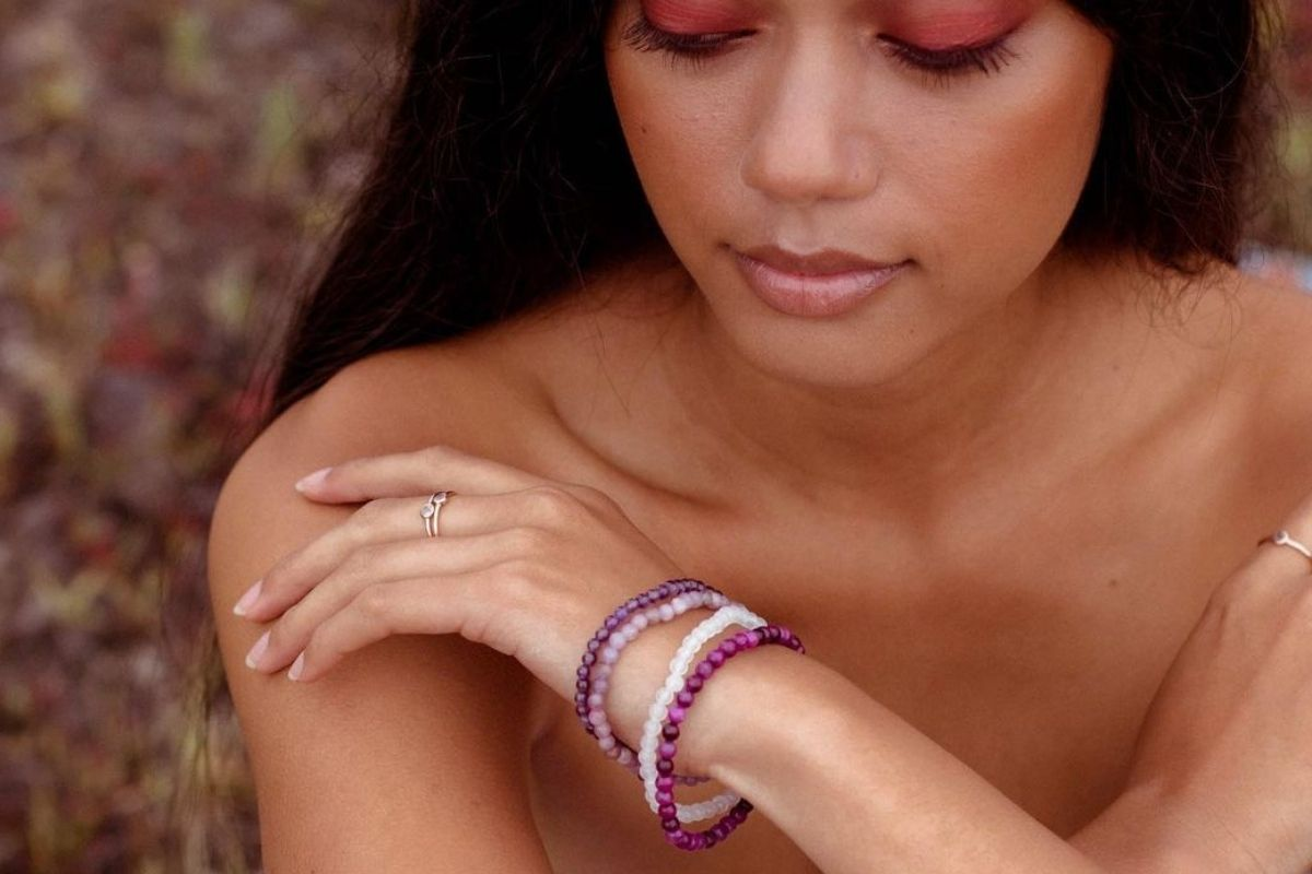 woman wearing gemstone bracelets