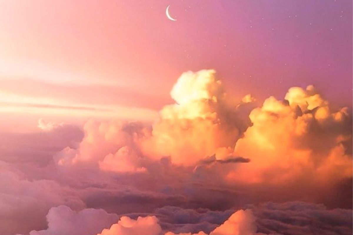 pink sky with clouds and moon