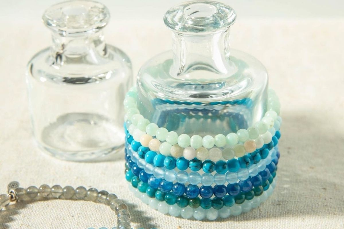 gemstone bracelets for memory wrapped around a clear jar