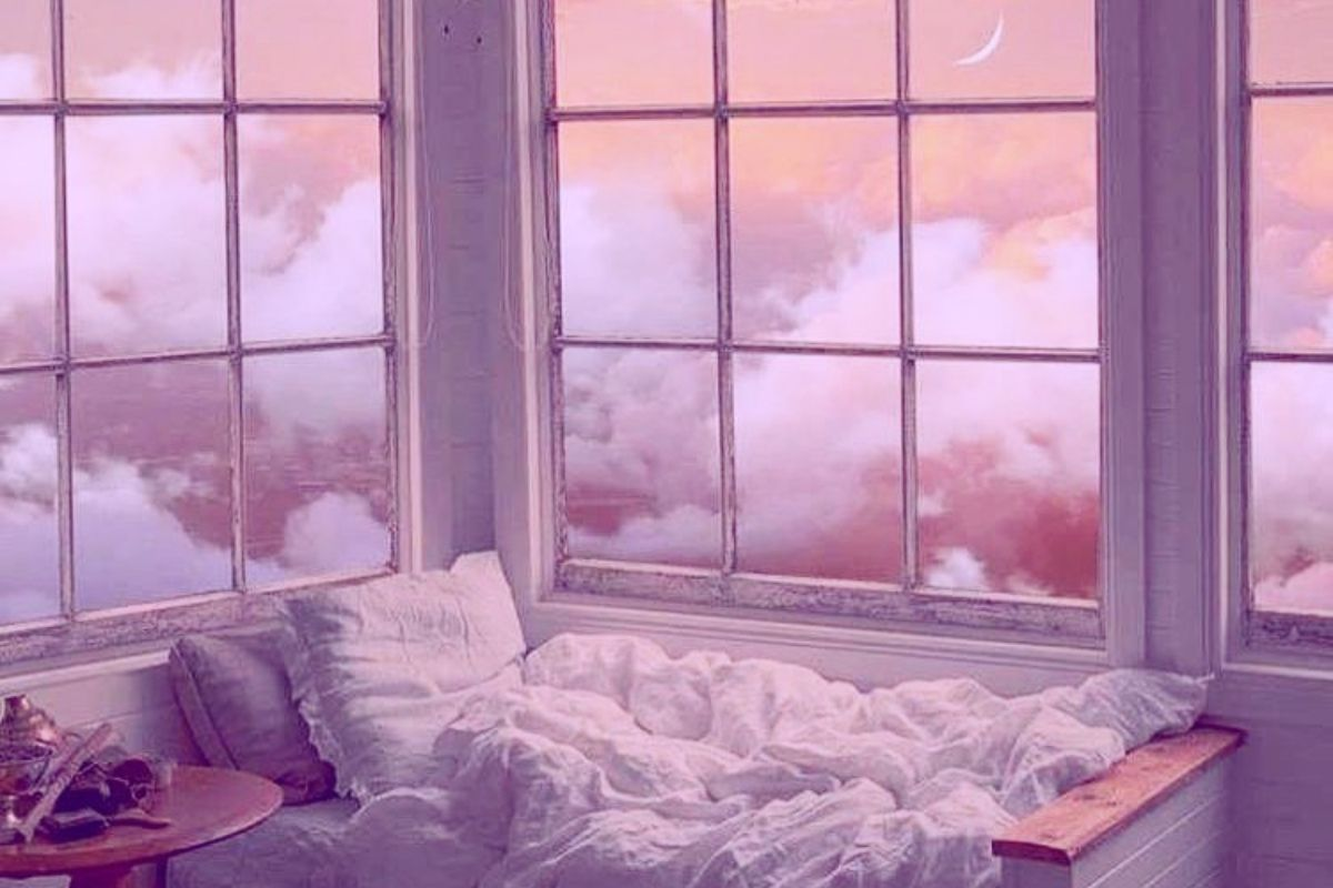 double bed against a window with clouds