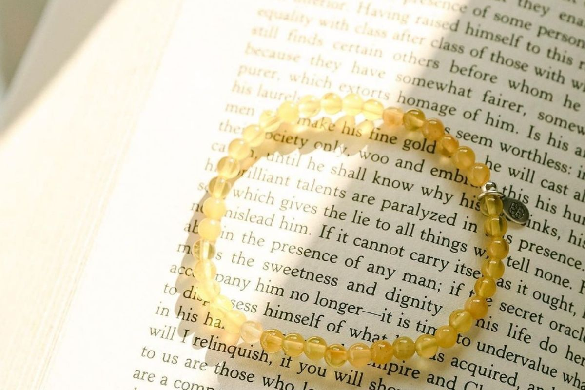 yellow topaz bracelet placed on book