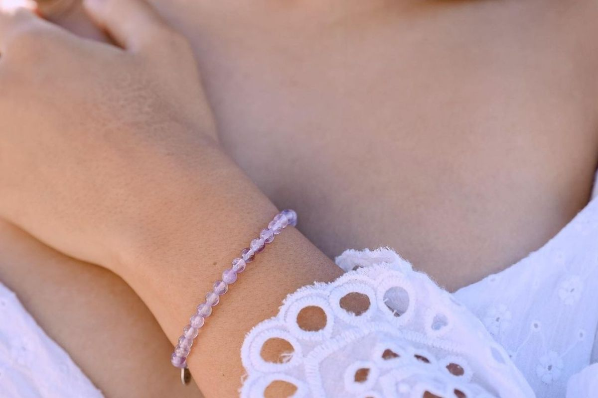 woman wearing lavender amethyst bracelet from Tiny Rituals