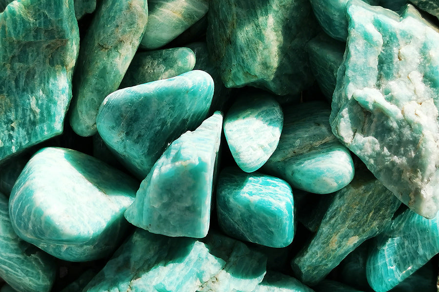 collection of amazonite stones in sunlight