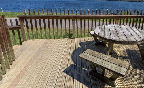 Antislip plus grooved non-slip timber decking shown against a seascape