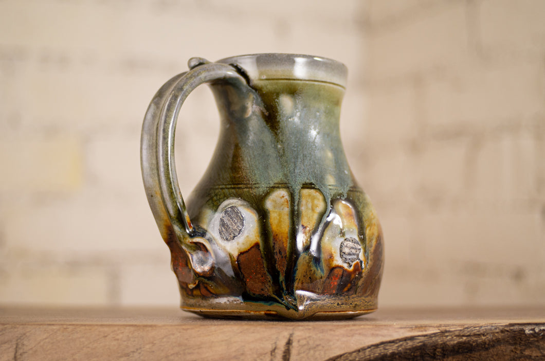Soda-Fired Mug on Shells