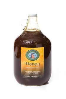 Honey with no Comb in Large Glass Moonshine Jar