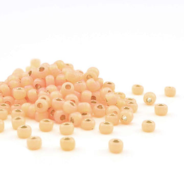 6-580-TB Dyed Pale Peach Silver Lined Alabaster  6/0 - Beadshop.com