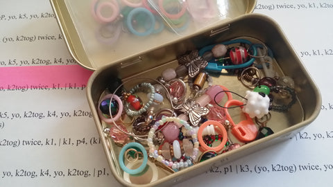 box of assorted stitch markers