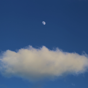 A cloudy blue sky with moon