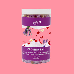 A sliced Refresh Lavender Vanilla bath salts jar with it's ingredients inside