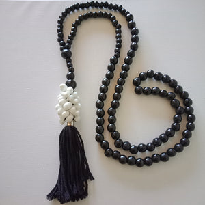 White Shells, Tassels and Black Beads.