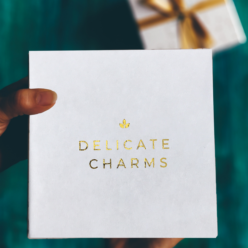 Delicate Charms gold foiled white box