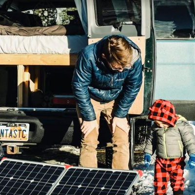 father-and-son-using-solar-for-van