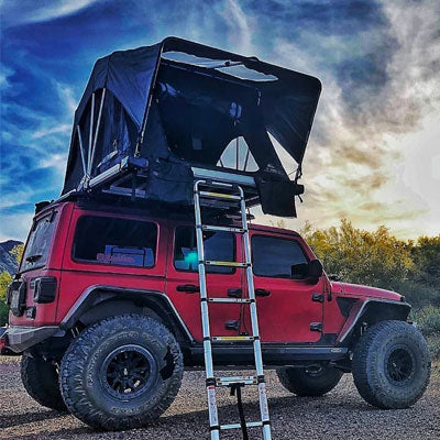 Jeep with tent on roof