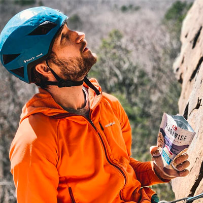 Rock climber eating readywise meal