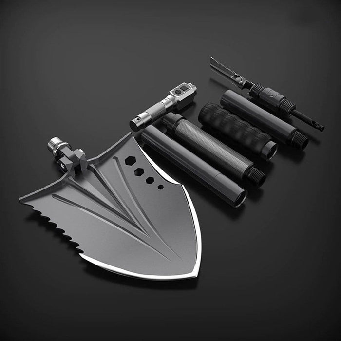 The Crotalus tactical shovel comes with bushcraft tools including a handsaw, knife, harpoon, fire starter, emergency whistle, LED light, bottle opener and camera mount.