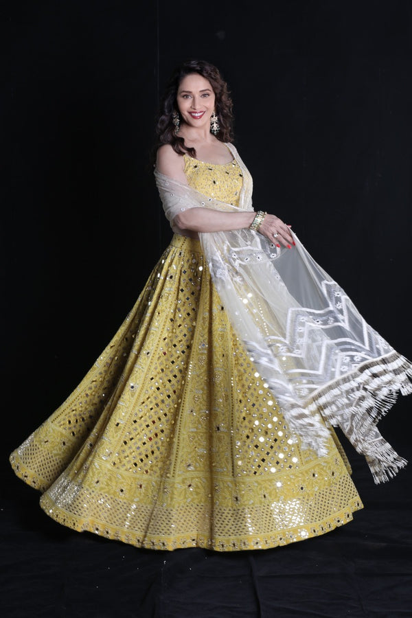 Madhuri dixit looks gorgeous in the fresh yellow ensemble