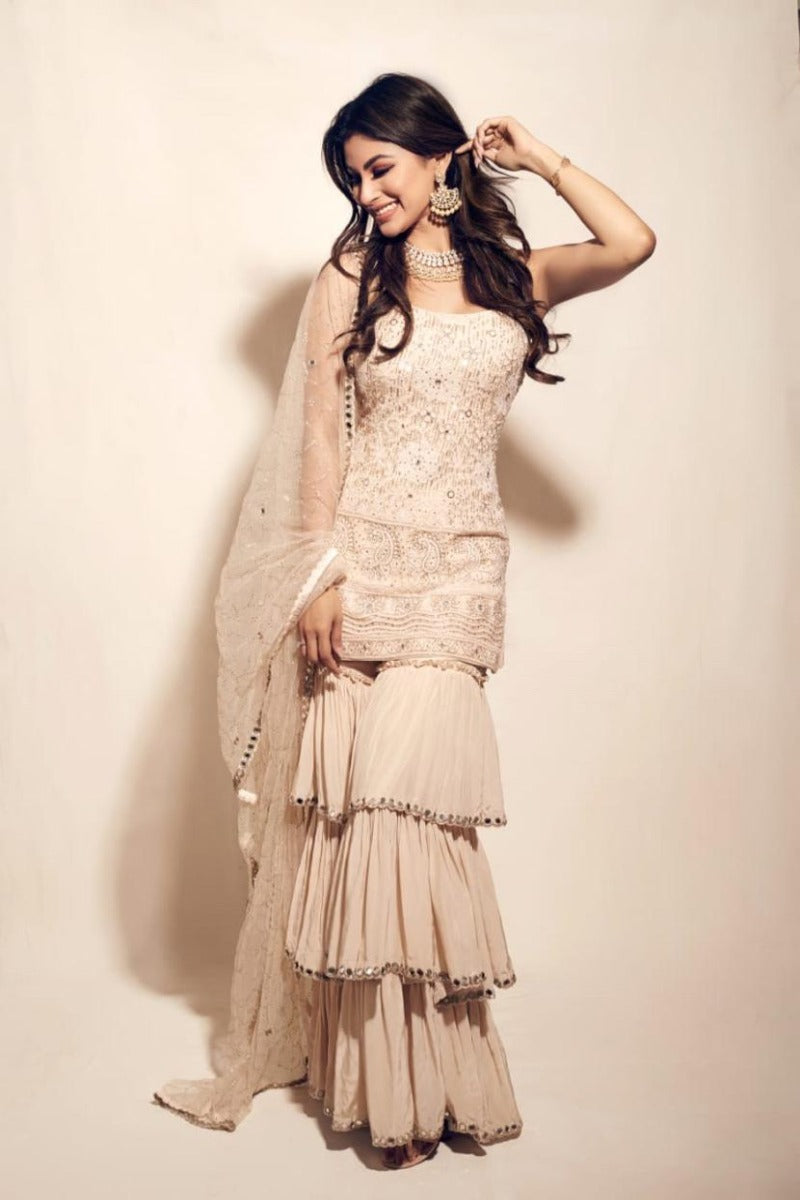 Mouni roy looks radiant in our ivory chikankari kurta with tiered sharara