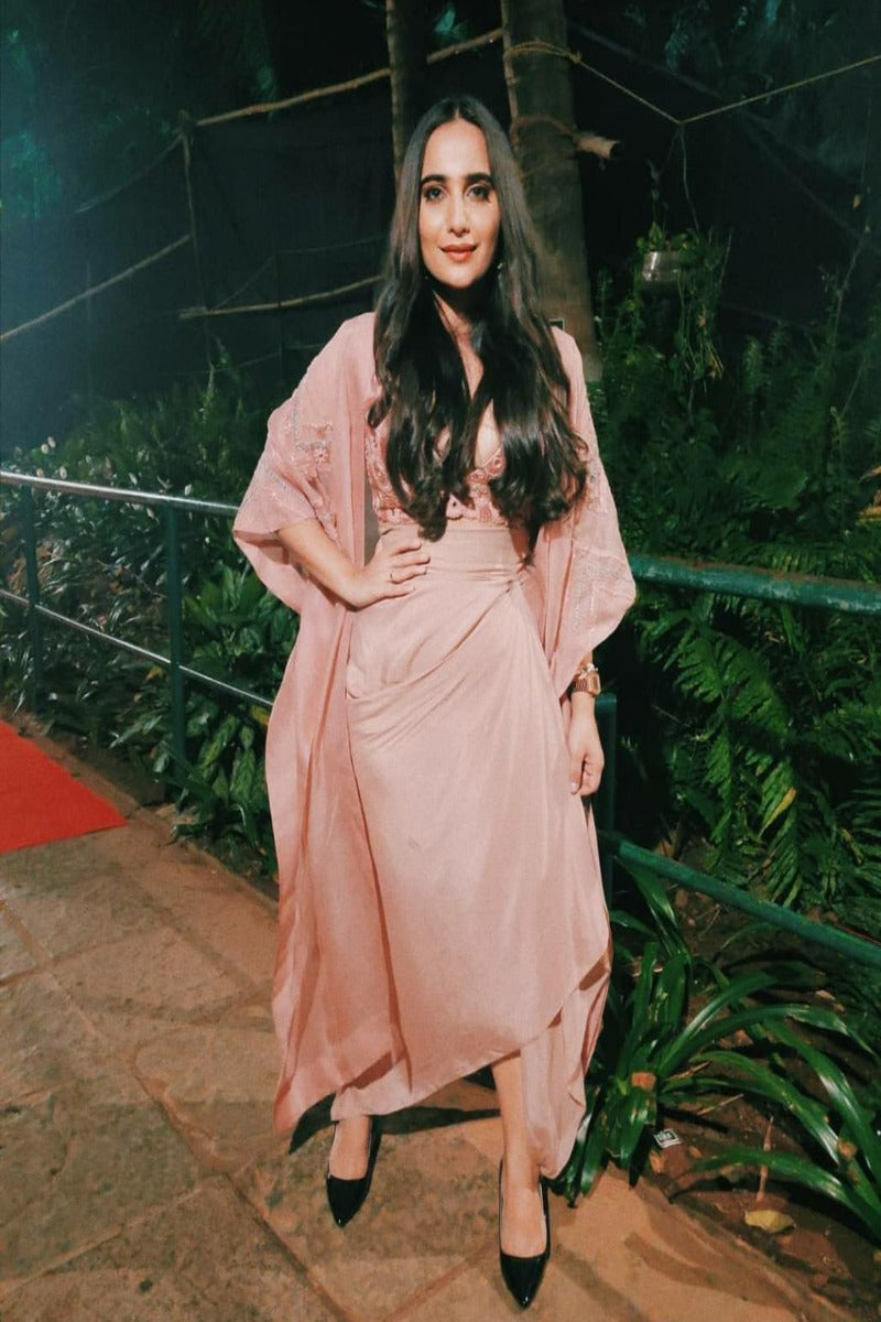Kusha Kapila looks utlra-stylish in blush pink top with draped dhoti and cape