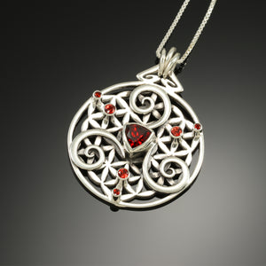 Flower of life geometry pendant with Red Garnets