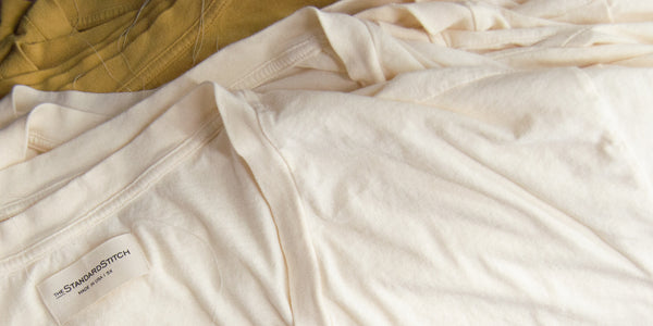 close up picture of the finished golden and bone v-neck t-shirt