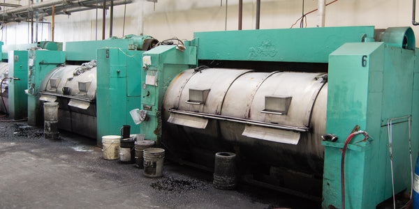 large teal dying machines at our dye house in Los Angeles