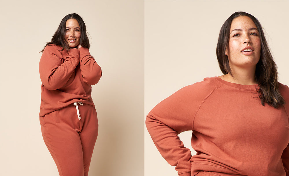 Two images of the same model. On the right model zoomed in on the sweatshirt and the left standing up full body image. Both images are in the recycled and organic cotton jogger and college pullover sweatshirt outfit set in Clay color