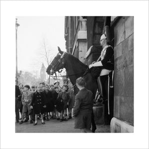 Children watch the horse guards: 1960